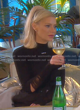 Dorit's black distressed sleeve knit top on The Real Housewives of Beverly Hills