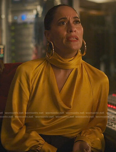 Grace's yellow draped blouse on The High Note