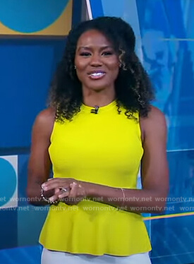 Janai's yellow sleeveless peplum top on Good Morning America
