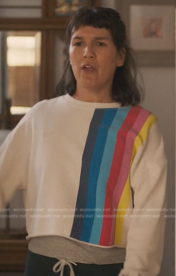 Katie's rainbow striped sweatshirt on The High Note