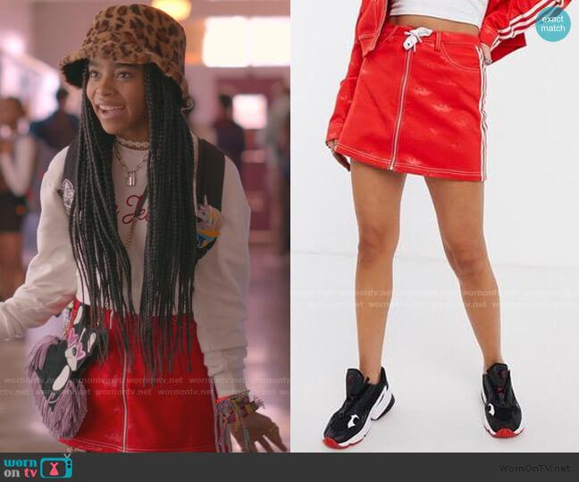 Trefoil Denim Mini Skirt by Adidas x Fiorucci worn by Flynn (Jadah Marie) on Julie & the Phantoms