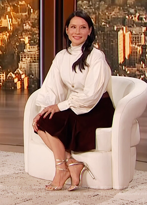Lucy Liu's white balloon sleeve blouse on The Drew Barrymore Show