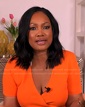Garcelle's orange wrap top on The Real