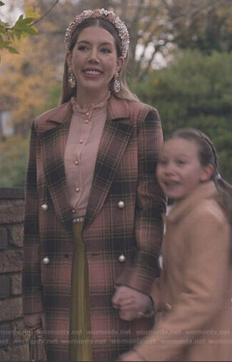 Katherine's pink ruffle blouse and plaid coat on The Duchess