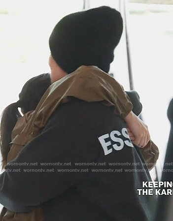 Khloe's black essentials hoodie on Keeping Up with the Kardashians