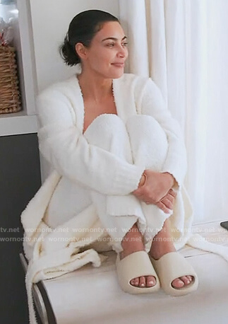 Kim's white knitted top pants and robe on Keeping Up with the Kardashians