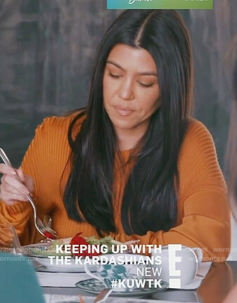 Kourtney's orange ribbed sweater on Keeping Up with the Kardashians