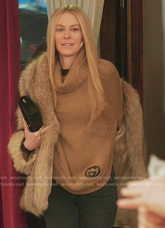 Leah's beige poncho sweater on The Real Housewives of New York City