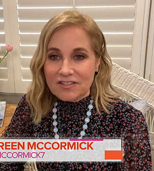 Maureen McCormick's black floral smocked neck blouse on Today