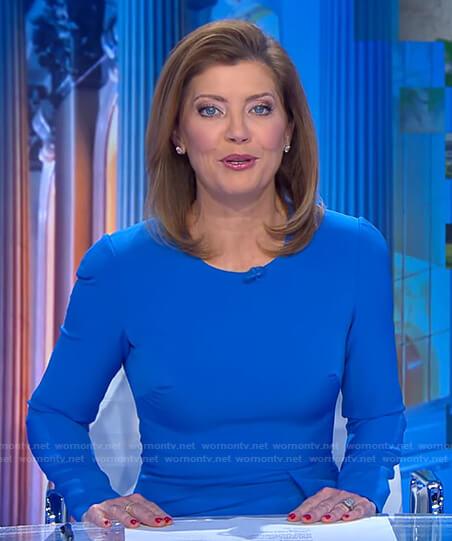 Norah's blue long sleeve dress on CBS Evening News
