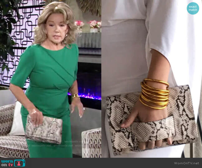 P Sherrod & Co KD Clutch in Snake Print worn by Nikki Reed Newman (Melody Thomas-Scott) on The Young & the Restless