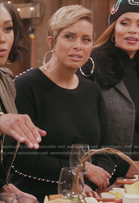Robyn's black pearl sleeve sweater on The Real Housewives of Potomac