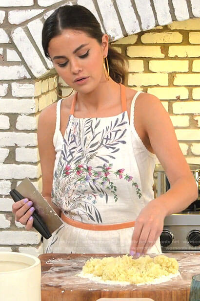 Selena's white floral apron on Selena + Chef