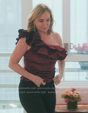 Sonja's burgundy ruffle top on The Real Housewives of New York