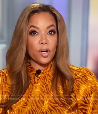 Sunny's orange metallic blouse on The View