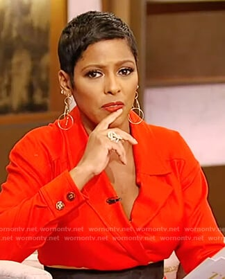 Tamron's red belted jumpsuit on Tamron Hall Show