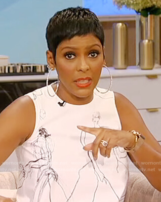 Tamron's white sleevless printed dress on Tamron Hall Show