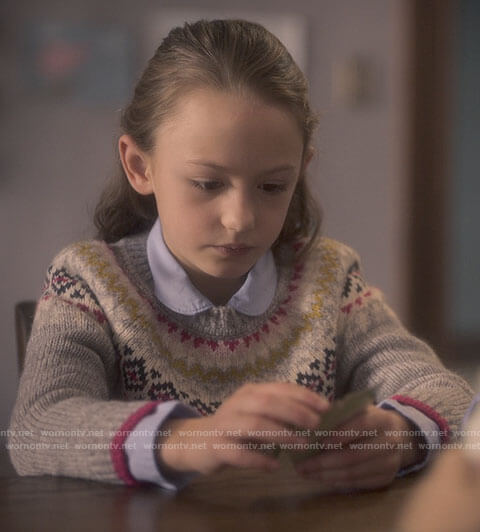 Flora's fair isle print sweater on The Haunting of Bly Manor