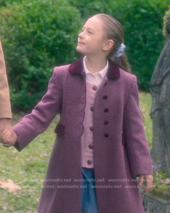 Flora's purple scalloped trim coat on The Haunting of Bly Manor