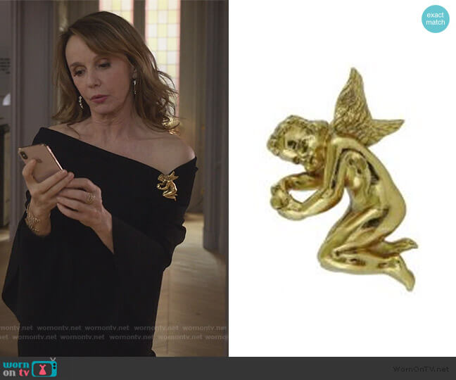 Vintage Gold Toned Cherub Brooch by Christian Dior worn by Sylvie (Philippine Leroy-Beaulieu) on Emily in Paris