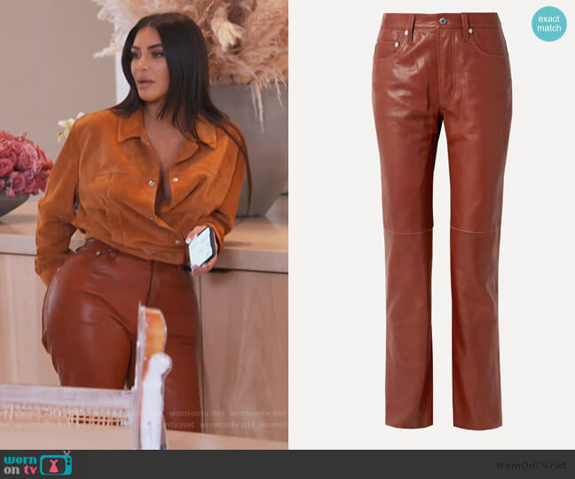 Leather straight-leg pants by Helmut Lang worn by Kim Kardashian  on Keeping Up with the Kardashians