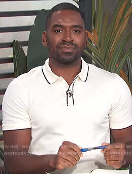 Justin's white contrast trim polo on E! News Daily Pop