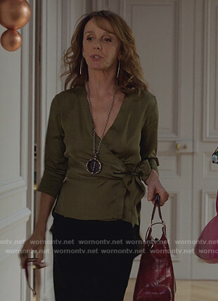 Sylvie's green wrap blouse and skirt on Emily in Paris