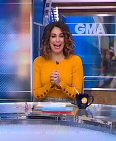 Cecilia's orange ribbed button-cuff sweater on Good Morning America