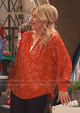Chelsea's orange floral blouse on Ravens Home