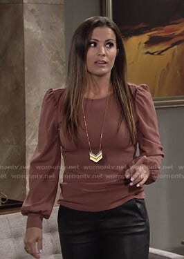 Chelsea's red puff sleeve top on The Young and the Restless