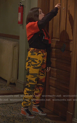 Tess's orange camo pants on Ravens Home