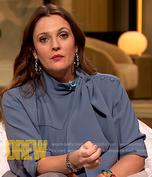 Drew's blue silk tie neck blouse on The Drew Barrymore Show
