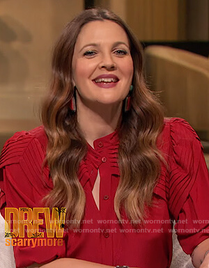 Drew's red ruffle blouse on The Drew Barrymore Show