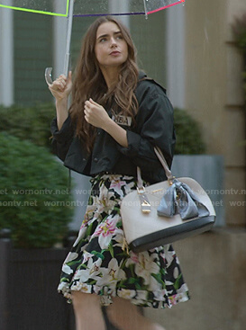 Emily's black jacket and floral print off-shoulder dress on Emily in Paris