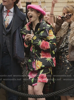 Emily's black floral dress and puffer jacket on Emily in Paris
