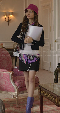 Emily's navy piped-trim cardigan and pearl-trimmed skirt on Emily in Paris