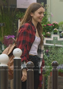 Emily's red layered plaid shirt on Emily in Paris