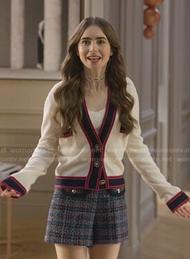 Emily's white contrast cardigan and plaid shorts on Emily in Paris