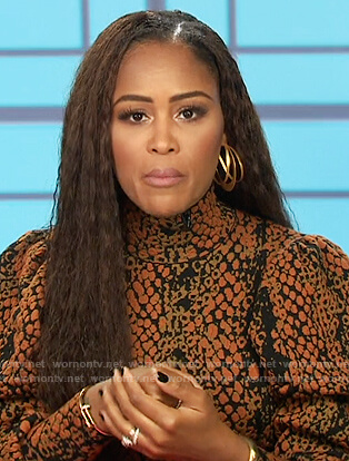 Eve's brown snakeskin top on The Talk