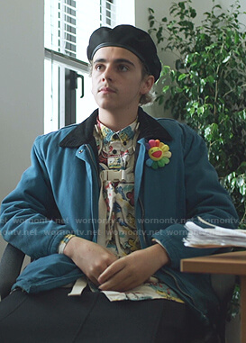 Fraser's blue jacket and flower brooch on We Are Who We Are