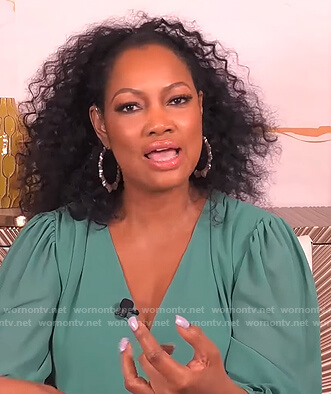 Garcelle's teal wrap blouse on The Real