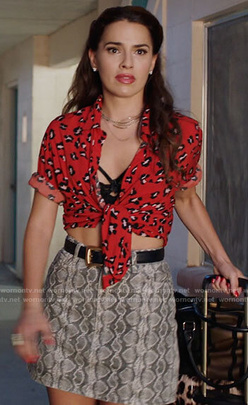 Ginger's red leopard print shirt and snake print skirt on Filthy Rich