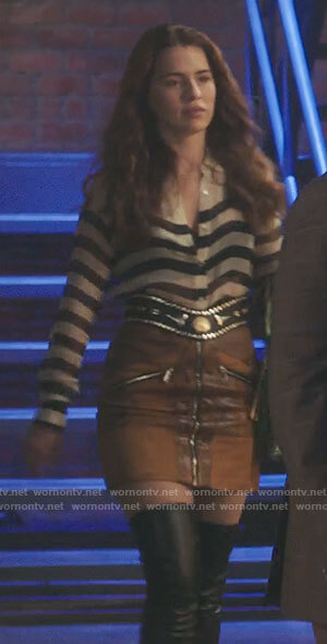 Ginger's striped blouse and tan leather zip-front skirt on Filthy Rich