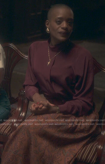 Hannah's burgundy blouse and orange paisley skirt on The Haunting of Bly Manor