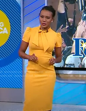 Janai's yellow tie neck sheath dress on Good Morning America