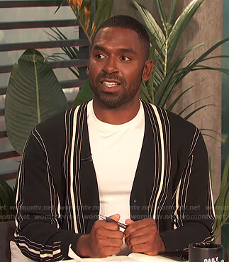 Justin's black striped cardigan on E! News Daily Pop