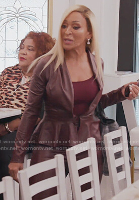 Karen's burgundy leather wrap top on The Real Housewives of Potomac