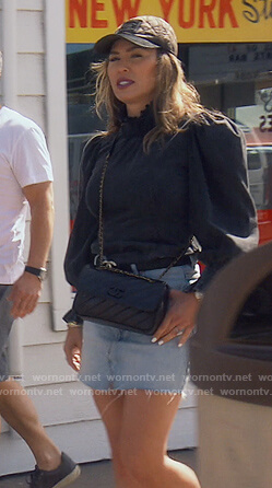 Kelly's black cc belt and cap on The Real Housewives of Orange County