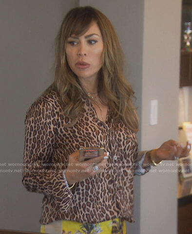 Kelly's leopard print blouse and yellow pants on The Real Housewives of Orange County