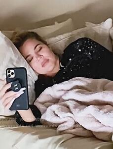 Khloe's black star print pajamas on Keeping Up with the Kardashians